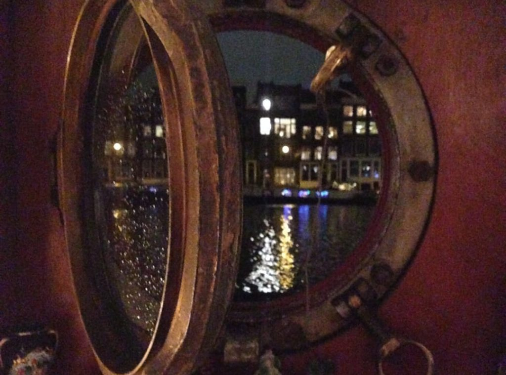 Porthole in Amsterdam boat stay airbnb experience