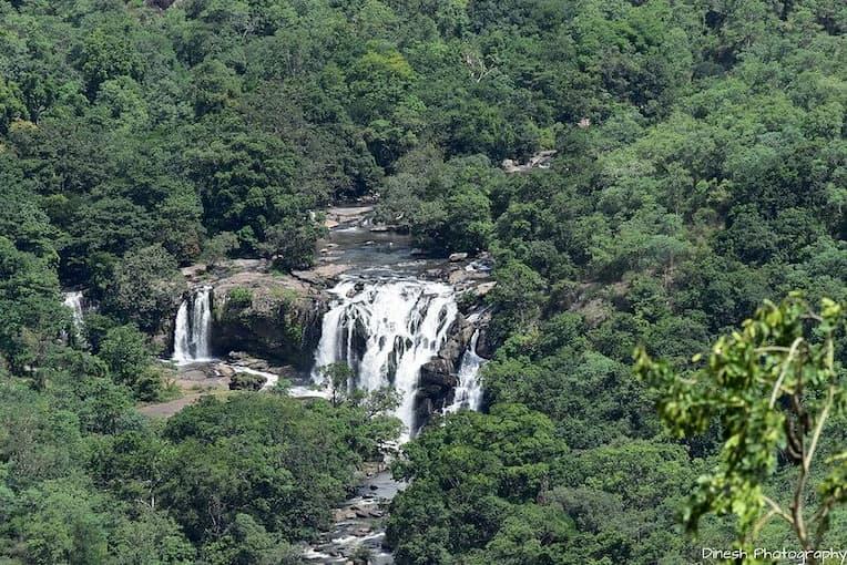Distant shot of Kanthalloor waterfall munnar